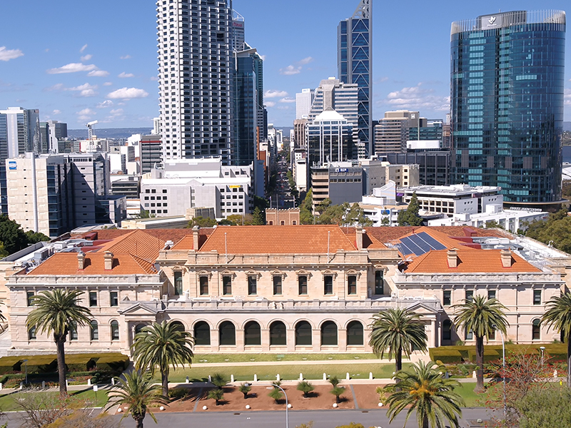 Aerial view of Parliament House with Perth skyline in the background