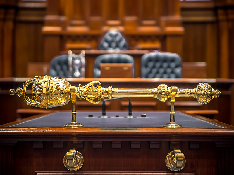 Legislative Assembly mace on table in the chamber