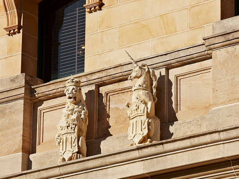 Concrete Lion and Unicorn sculptures on the western facade of Parliament House