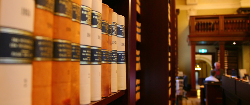 Hansard bound volumes on a shelf in the Parliamentary library
